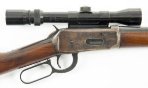 A side scope mounted on a Winchester 94 rifle