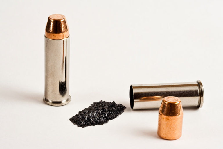 2 bullets with shell casing and gunpowder